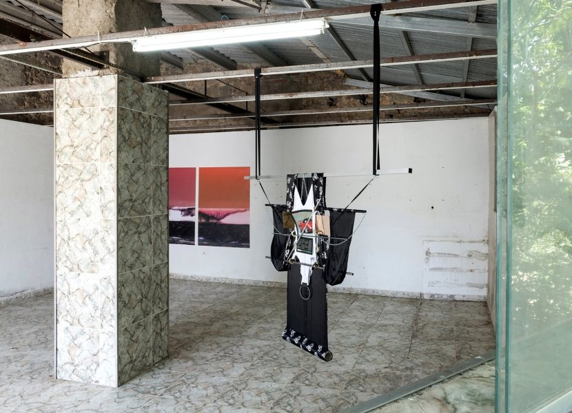 Estrid Lutz. Fading through, Zicatela series, Puerto Escondido, 2019. Digital print on photographic paper. Image by Roberto Ruiz. Courtesy of the artist and Spirit Vessel. Sahatsa Jauregui. El Hijo de, 2019 Kimono costume, bathing suit, magazine page, iron bars, mirror, chain and cardboard cylinder. Image by Roberto Ruiz. Courtesy of the artist and Spirit Vessel