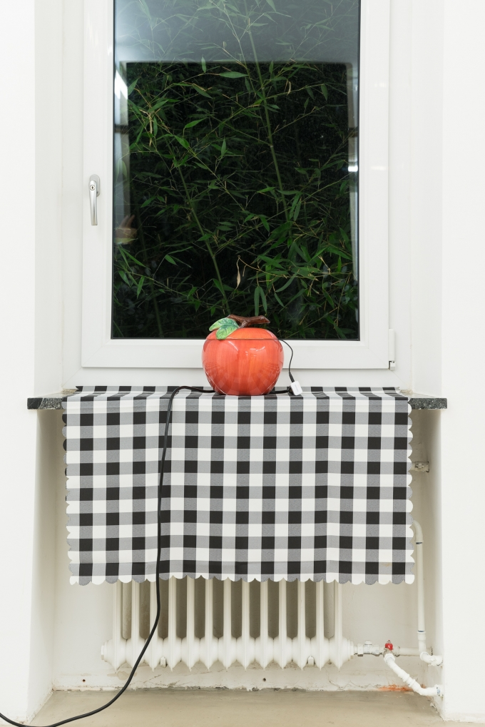 Brandon Covington Sam-Sumana, Cold Fruit Flambé, 2019, Cookie Jar encasing portable speaker and microSD, Plant Stand, Vinyl Tablecloth, Extension Cable